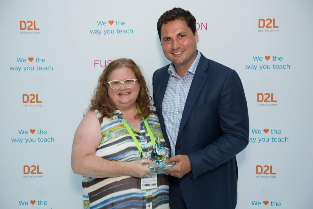 Brightspace Excellence Award winner Dr. Jodi Henderson-Ross with D2L CEO John Baker